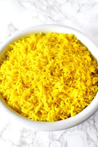 Yellow rice in a white bowl