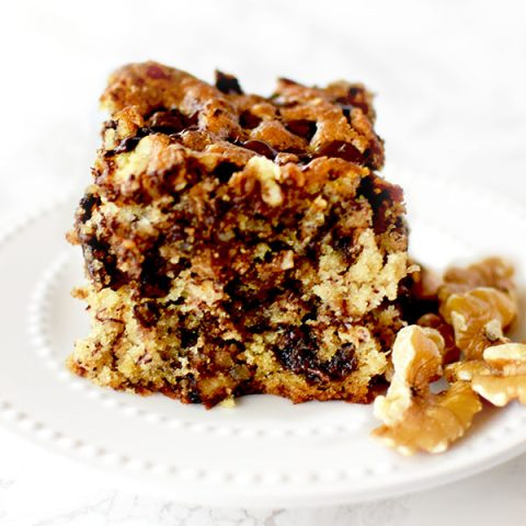 chocolate chip banana cake with nuts on a white plate