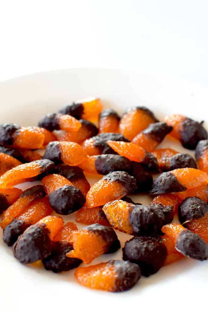 A pile of candied kumquats dipped in chocolate