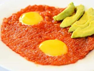Huevos Rancheros with a side of avocado