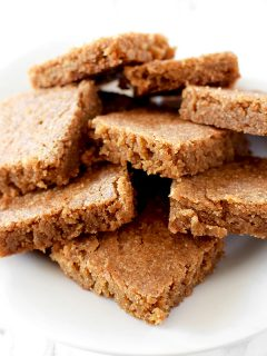 Blondies piled on a plate