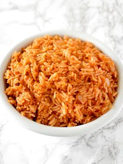 israeli red rice in a white bowl