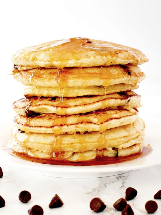 stack of dairy free chocolate chip pancakes on a white plate