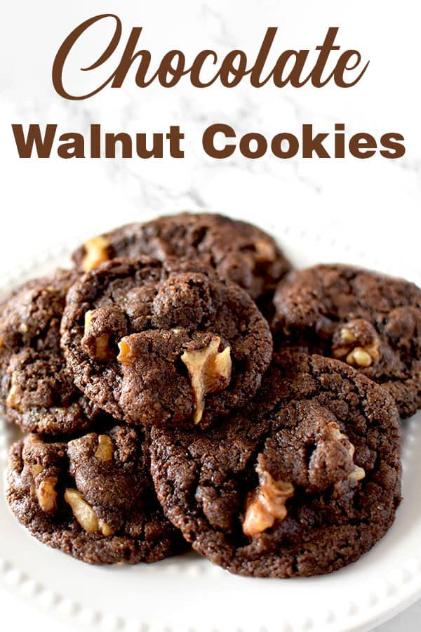 chocolate walnut cookies piled on a plate