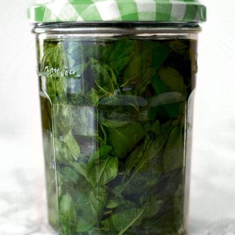 mint extract in a glass jar with a green lid