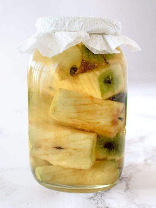 apple cores in a glass jar to make apple cider vinegar