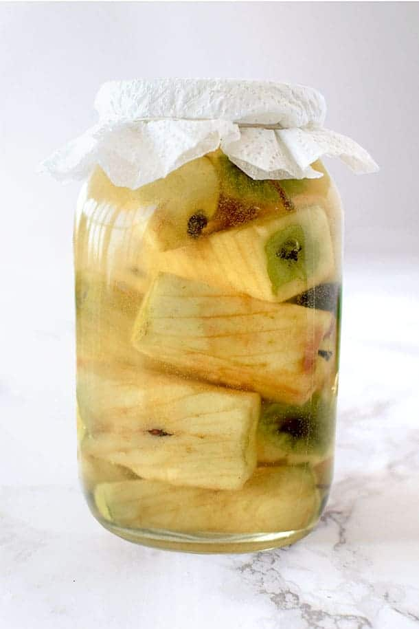 apple cores in a glass jar to make apple cider vinegar