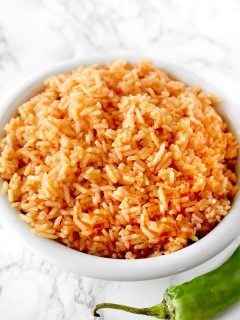 arroz rojo in a bowl on a marble counter