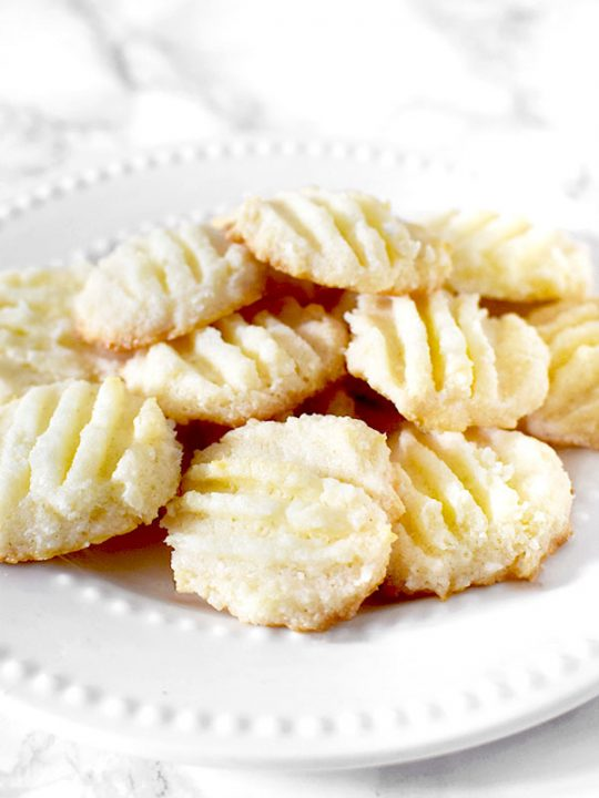 Biscoitos de Maizena or cornstarch cookies on a plate