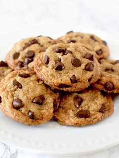 a pile of chocolate chip cookies on a plate