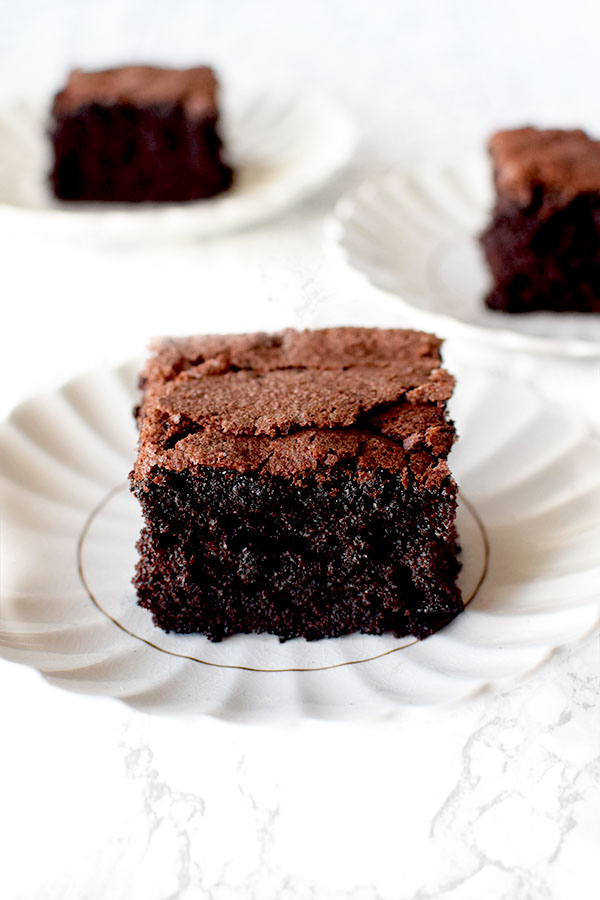 three slices of gluten Free Passover Chocolate Cake on white plates