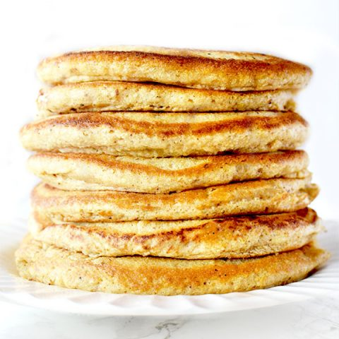 Stack of Passover Pancakes on a white plate sitting on a white marble counter