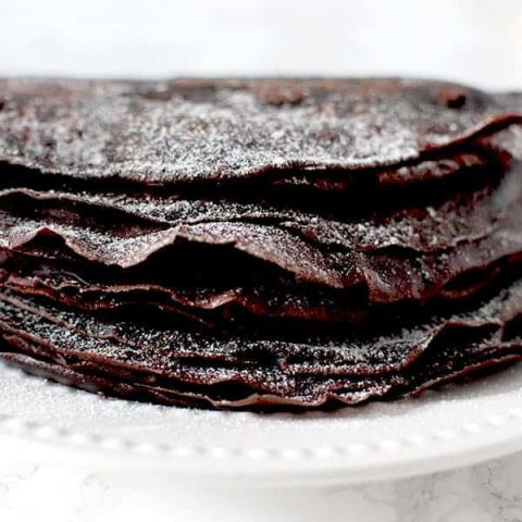 Gluten free Passover chocolate crepes sprinkled in powdered sugar