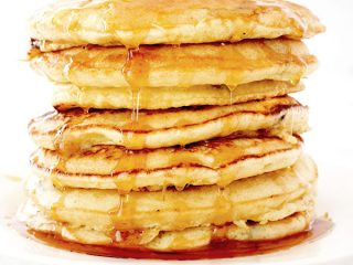 Pancakes stacked up on a plate