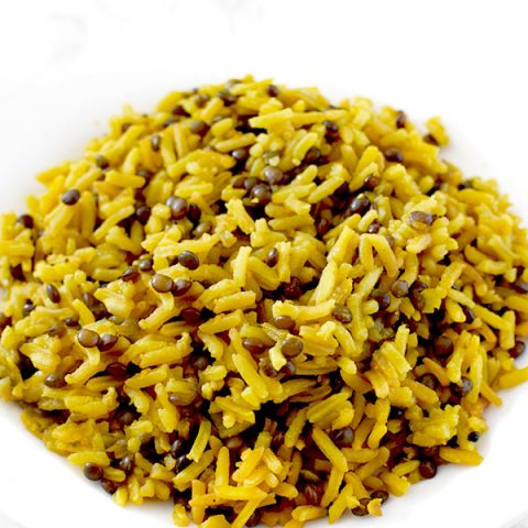 Yellow mujadara piled on a plate
