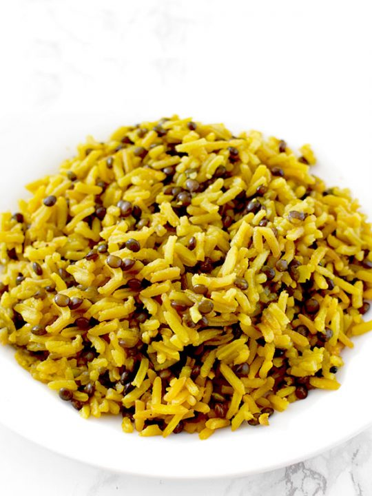 Yellow mujadara piled on a plate