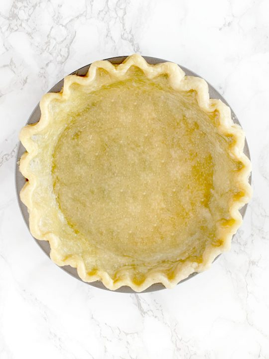 Pie crust made with oil on a white marble counter