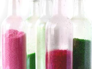 homemade colored sugar in bottles