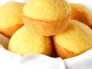 Southern cornbread muffins stacked in a bowl
