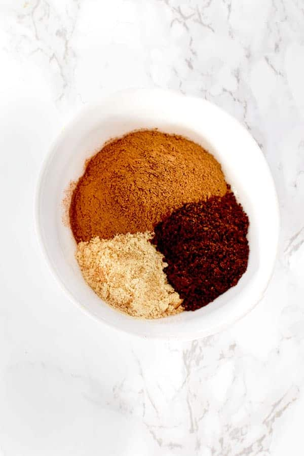 cinnamon, ginger, and cloves in a bow from pumpkin spice mix