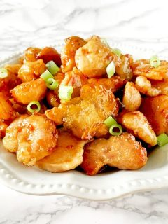 A plate of panda express (copycat) orange chicken
