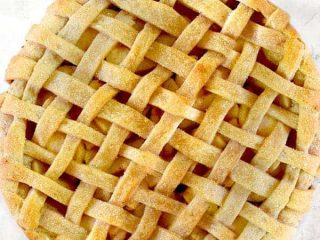 Apple pie on a white marble counter