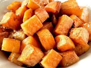 cubes cinnamon and brown sugar roasted butternut squash on a plate