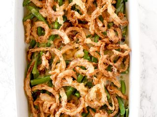 Dairy free green bean casserole on a white marble counter