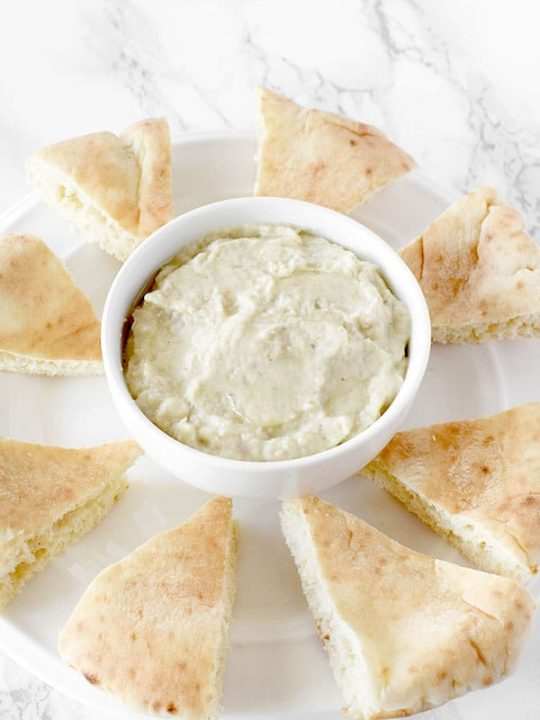 Baba Ghanoush on a plate with pita