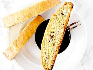 mandel bread with almonds on a plate and coffee cup