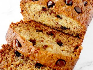sliced banana chocolate chip bread on a white marble counter