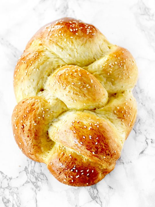Challah bread on a white marble counter