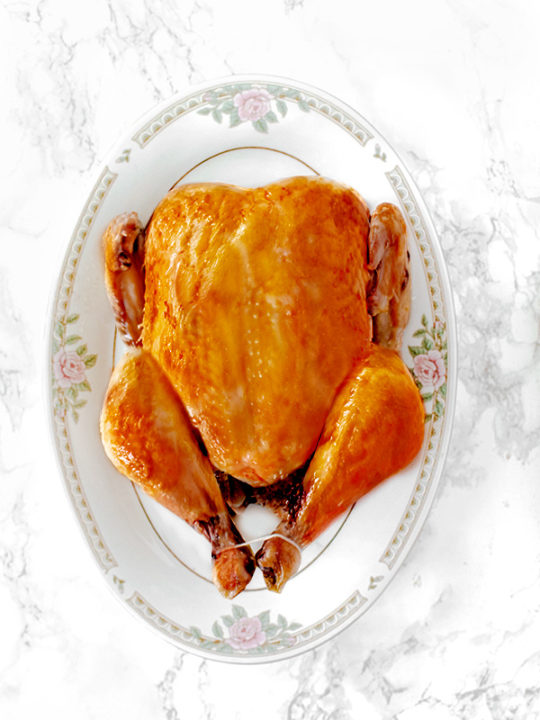 dairy free roasted turkey on platter on a white marble counter