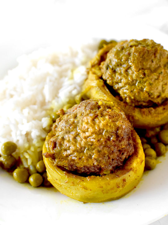 Stuffed Artichoke Bottoms on a Plate with rice and peas