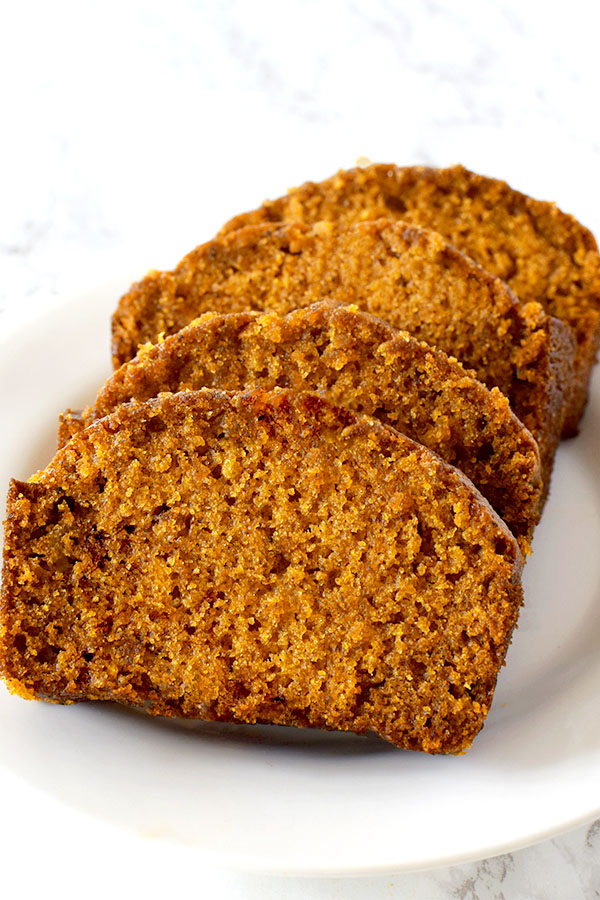 slices of dairy free pumpkin bread on a white plate